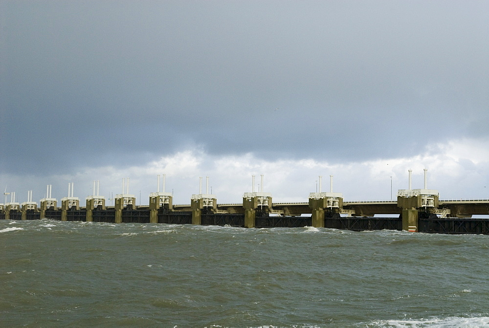 Closed storm surge barrier The Oosterscheldekering (Eastern Scheldt storm surge barrier) between the islands Schouwen-Duiveland and Noord-Beveland, part of the Delta works series of dams, protecting the Netherlands from flooding, Netherlands