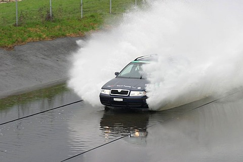 Aquaplaning area in a driving safety center. Emergeny situations in deep water are practiced here. They can occur on highways after heavy rain, when vehicles at high speed hit deep water that cannot be dipslaced by the tires.