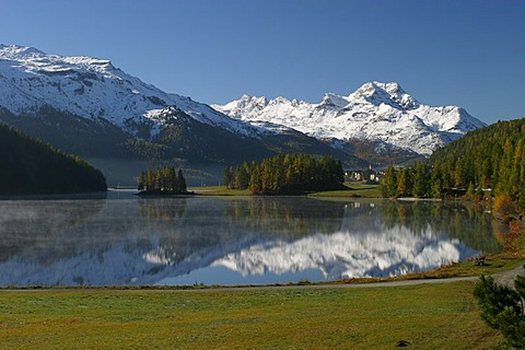 Fall in the engadine. The mountaintops are already snow covered while the engadin lakes are still reflecting the mountain scene.