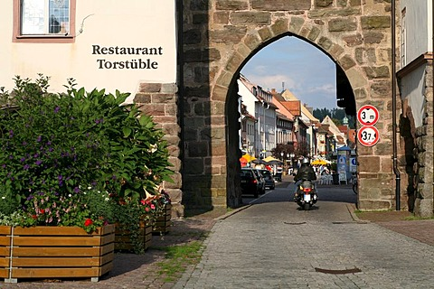 A motor scooter drives through one of the town gates to historic Villingen, Villingen-Schwenningen, Baden-Wurttemberg, Germany
