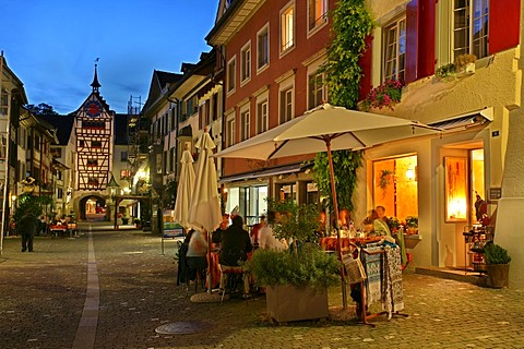 Restaurants, timber-framed houses and the tower of the Untertor gate in the historic old town of Stein am Rhein, Schaffhausen, Switzerland