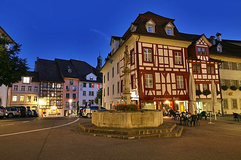 Town fountain and timberframe houses in the historic city center of Wil, St. Gall, Switzerland