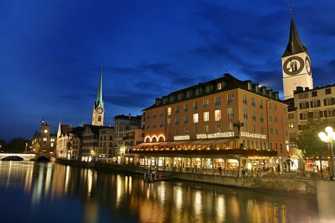 Saint Peter Church, Fraumunster and the lights of the old town reflecting in the Limmat, Zurich, Switzerland