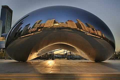 Cloud Gate at sunrise on Lake Michigan shore in front of the Chicago skyline, Illinois, USA