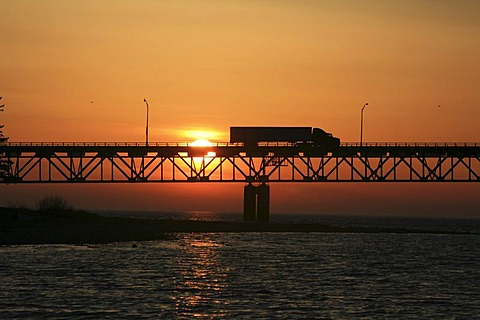 Truck driving across Mackinac Bridge across the Straits of Mackinaw between Mackinac City and St Igance, Michigan, USA