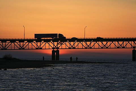 Truck driving across Mackinac Bridge across the Straits of Mackinaw between Mackinac City and St Igance, Michigan, USA