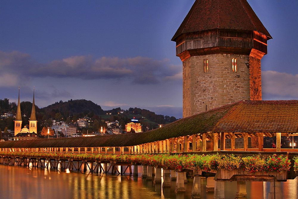Historic Kapell Bridge, Water Tower and Hofkirche Church (in background), Lucerne, Switzerland