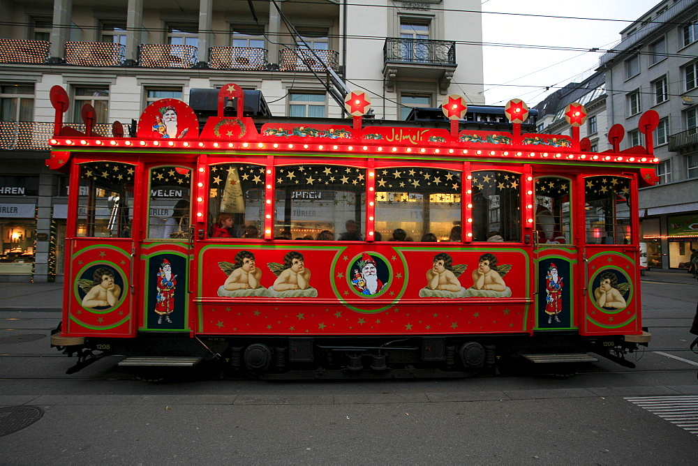 Historic fairytale tram on a round course in downtown Zurich from Bellevue - Limmatquai - Bahnhofstrasse, Zurich, Switzerland
