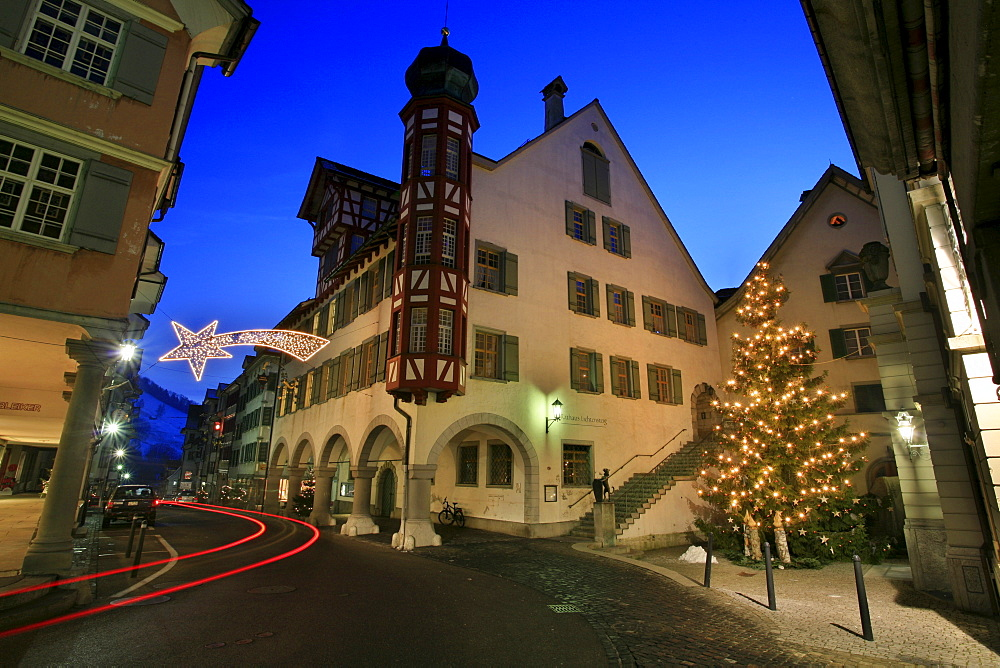 Christmas illumination on main street with historic houses and town hall of Lichtensteig, St. Gall, Switzerland