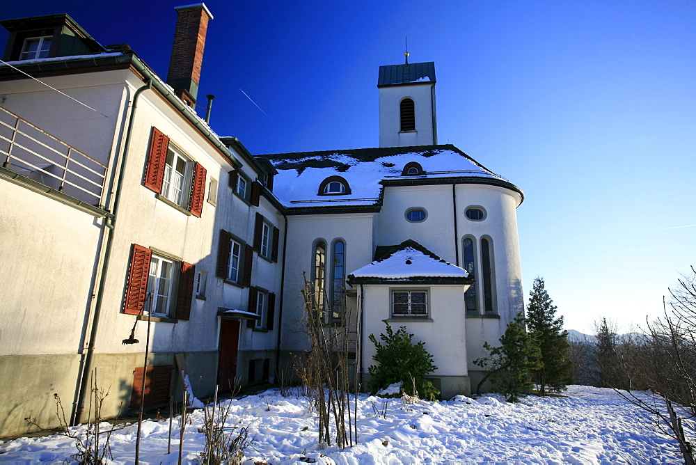 The Church of St. Iddaburg is sitting on the hill where the old Toggenburg castle stood high above Kirchberg village, St. Gallen, Switzerland