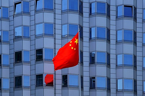 National flag blowing in the wind in front of the facade of the Chinese embassy, Berlin, Germany, Europe