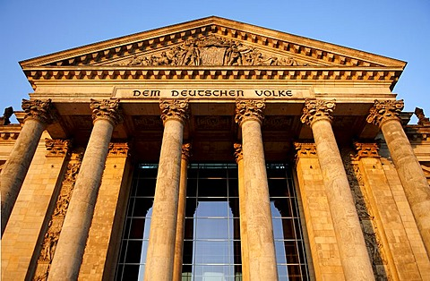 Pillared entrance to the Reichstag or German parliament in evening light, Berlin, Germany, Europe