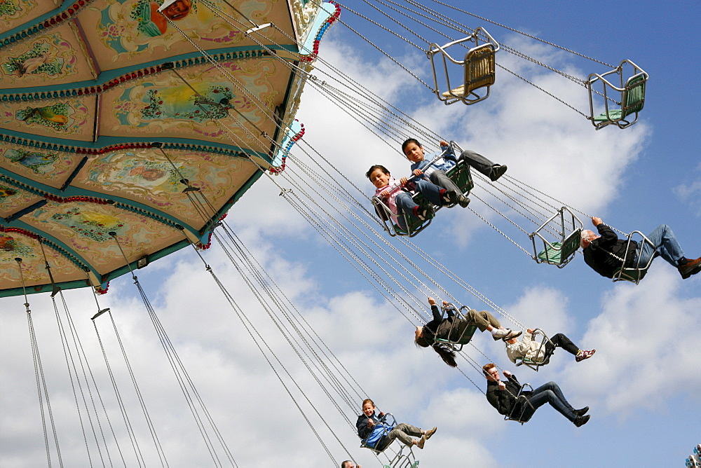 People driving with a chairoplane, Hamburg, Germany