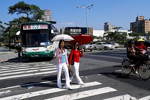 Two taiwanese women on the crosswalk in Taipei City, Taiwan