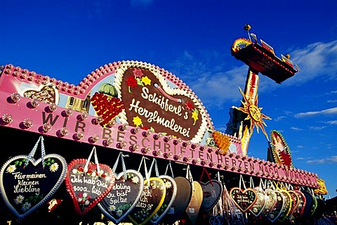 Gingerbread hearts and a fun ride, Oktoberfest, Munich, Bavaria, Germany