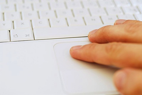 Hand on notebook keyboard