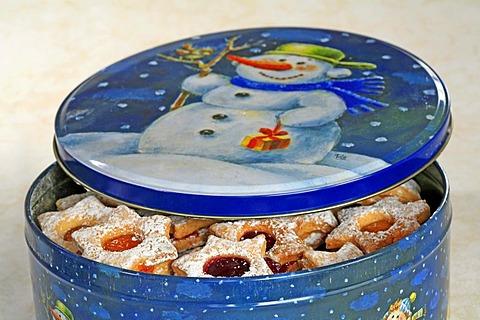Half opened cokkie box with chrismas cookies