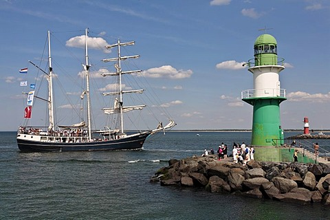 Barkentine named Thalassa next to the lighthouse of the Westmole, Hanse Sail 2008 in Warnemuende, Mecklenburg-Western Pomerania, Germany, Europe