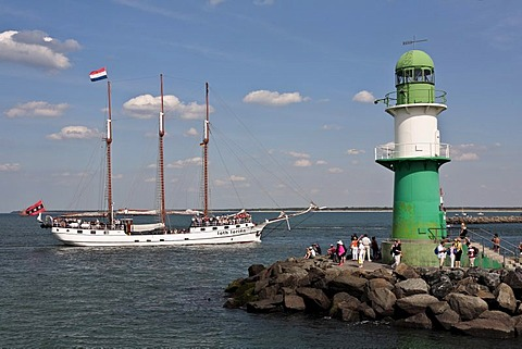Three-masts Schooner named Loth Loriën next to the lighthouse of the Westmole, Hanse Sail 2008 in Warnemuende, Mecklenburg-Western Pomerania, Germany, Europe