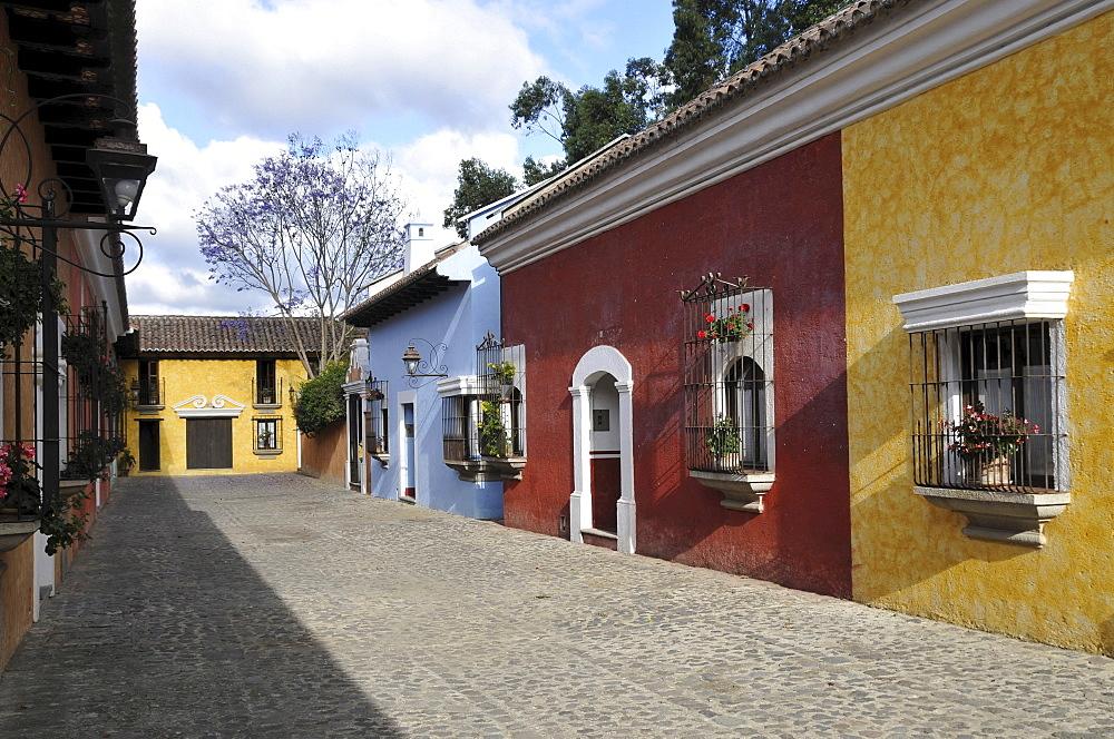 Colourful row of houses, Villa Colonial Hotel, Antigua Guatemala, Guatemala, Central America