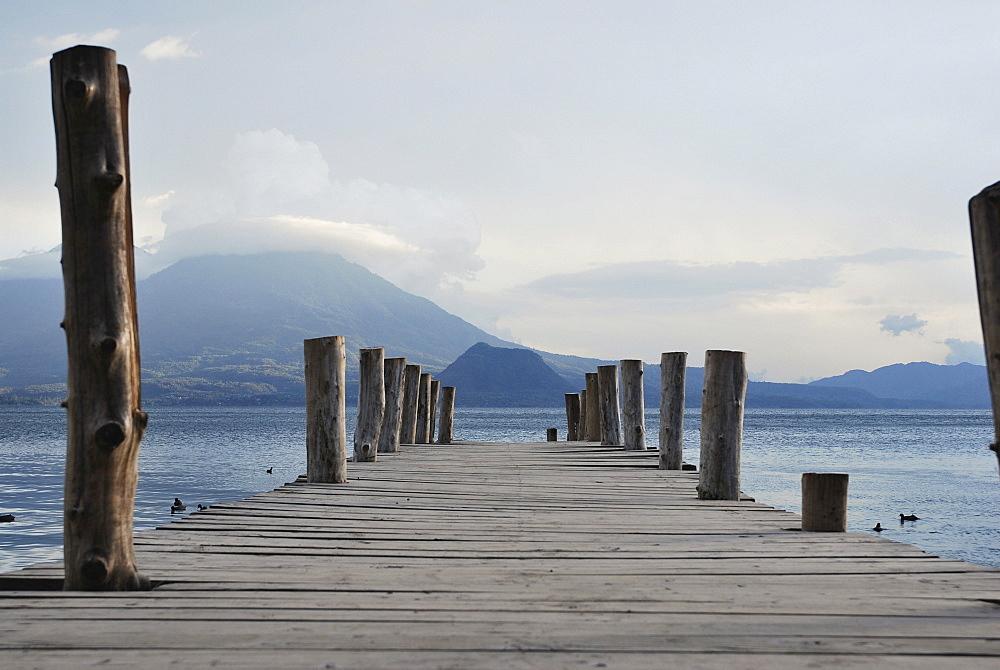 Wooden jetty, volcano, Lake Atitlan, Guatemala, Central America