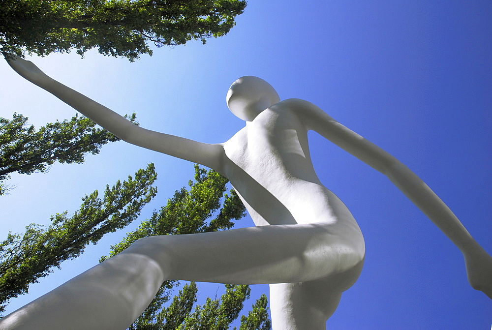 Walking Man, Sculpture in front of the building of the Muenchener Rueckversicherung, Leopoldstrasse, Munich, Bavaria, Germany