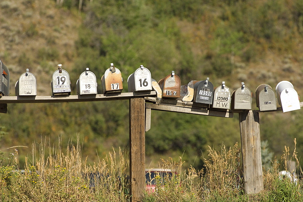Row of mailboxes on the side of the road in Wyoming, USA