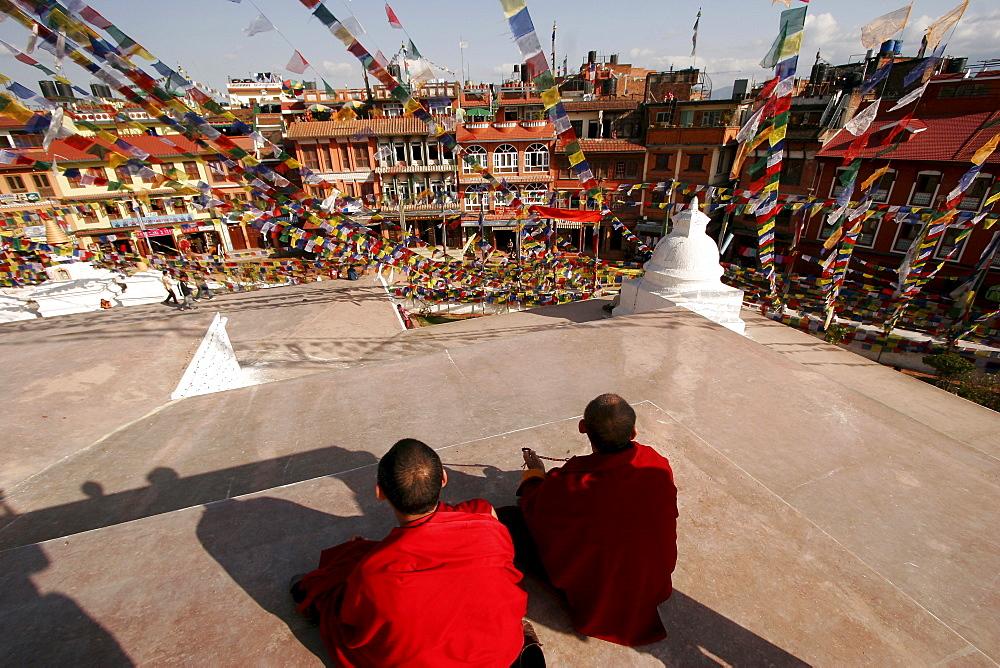 Buddhist monks at the stupa of Bodnath, a northeastern suburb of Kathmandu, Nepal, Asia