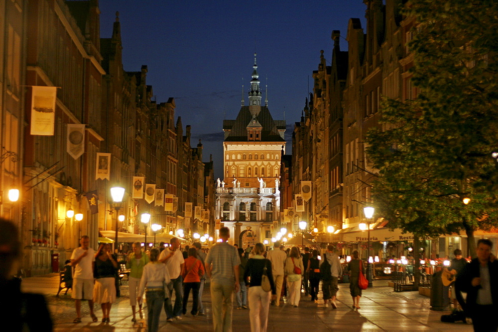 Pedestrian street and the Golden Gate at night, Gdansk, Poland, Europe