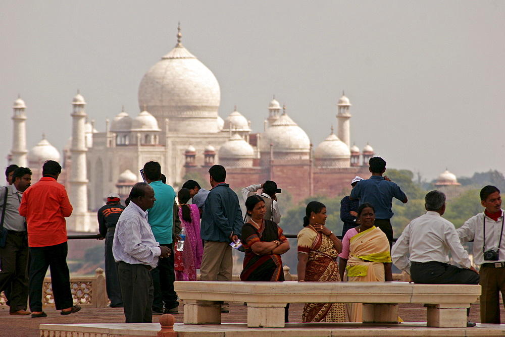 Indian tourists visiting the Red Fort of Agra, with the Taj Mahal in the background, Agra, Uttar Pradesh, India, Asia