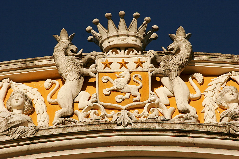 Renovated colonial building, Banco de America Central in Granada, emblem of lions holding a crown, Granada, Nicaragua, Central America