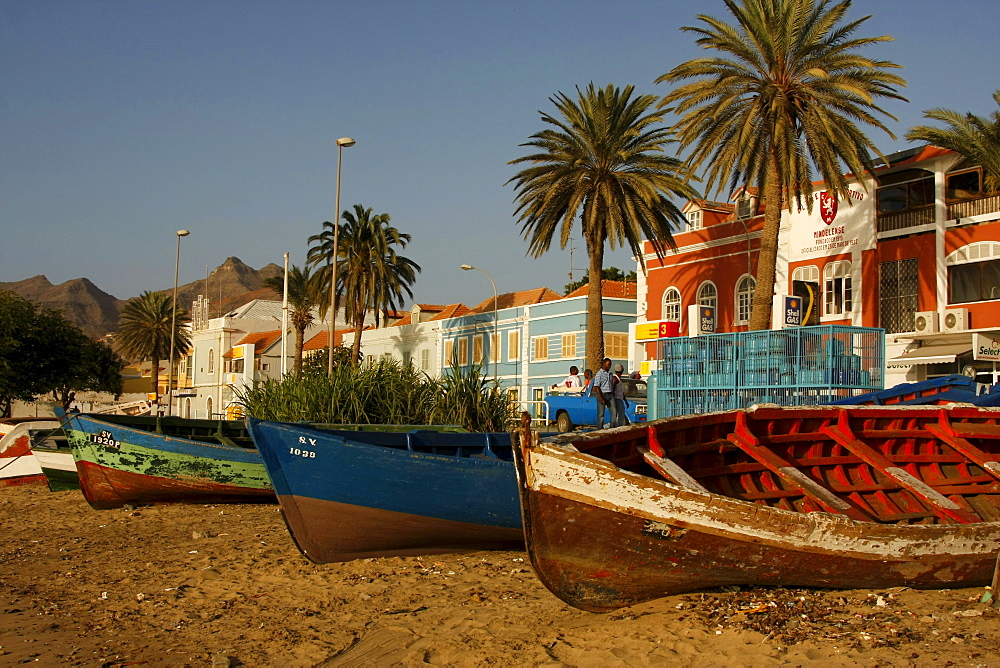 Rowboats pulled onto the beach in front of the coastal promenade of Mindelo on Sao Vicente Island, Cape Verde Islands, Cape Verde, Africa