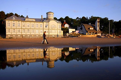 The former public swimming pool of E. Racene is reflected in the shallow water at the beach of Jurmala, Latvia, Baltic region, Europe