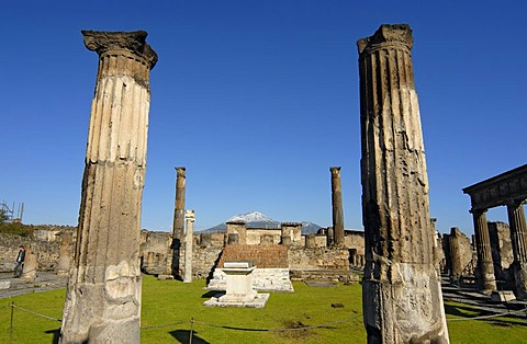 Temple of Apollo in front of the snow-capped Mount Vesuvius Volcano, Pompeii, Italy, Europe
