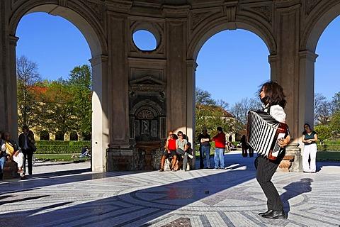 Accordionist in the Diana temple, Hofgarten, Munich, Bavaria, Germany