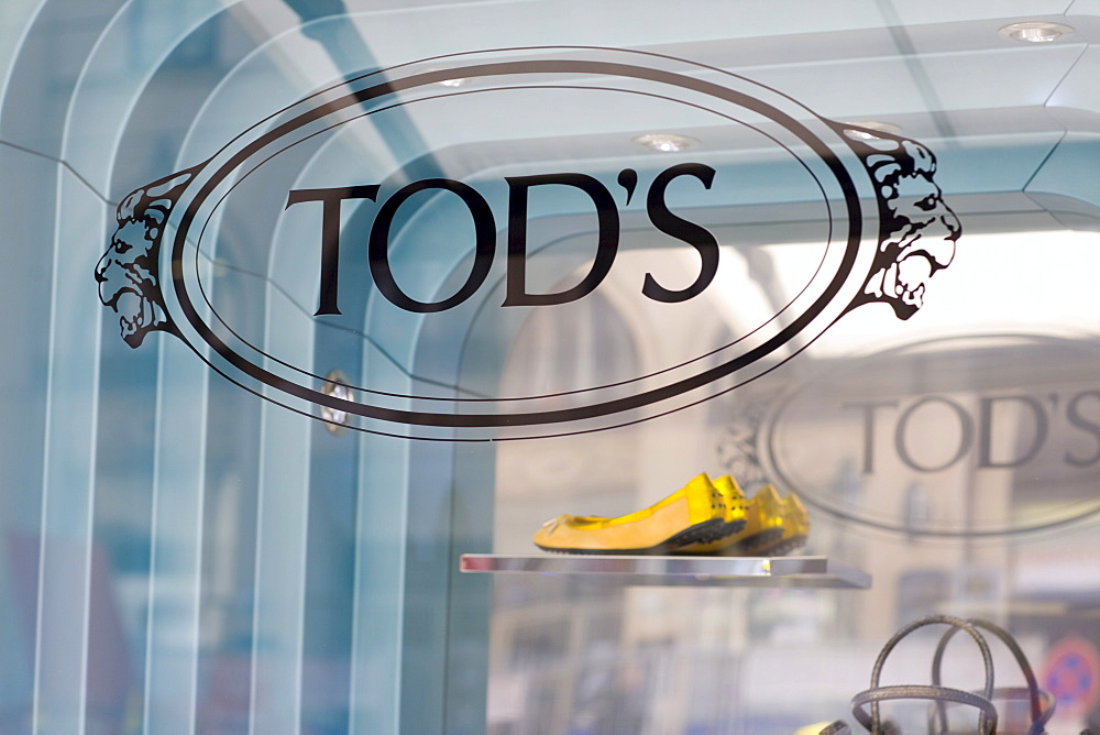 Yellow ballerina shoes in the window display of Tod's fashion boutique on the Maximilianstrasse, Munich, Bavaria, Germany