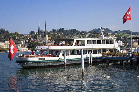 Ship and the cathedral of St. Leodegar, Lake Lucerne, Switzerland, Europe