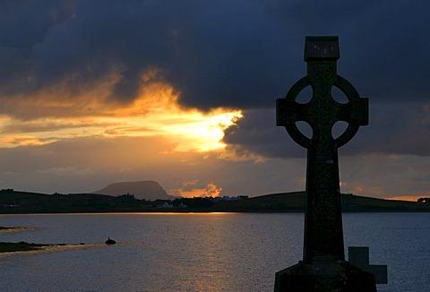 Celtic cross at sunset