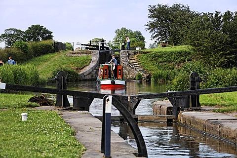 Boat in chanal between locks, Congleton, Cheshire, England