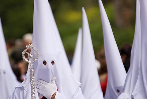 Penitents in white robes, Semana Santa procession, Granada, Andalusia, Spain