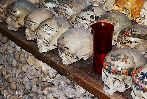 Painted skulls in the ossuary of Hallstatt, Salzkammergut, Upper Austria, Austria