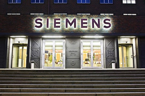 Wernerwerk multistrory building in the evening, entrance, sign, Siemens AG, Berlin, Germany.