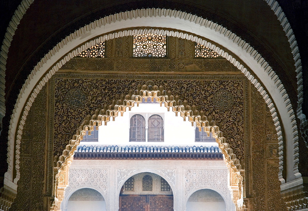 Highly ornate Moorish arches, intricate wood carving in the Alhambra fortress, Granada, Andalusia, Spain