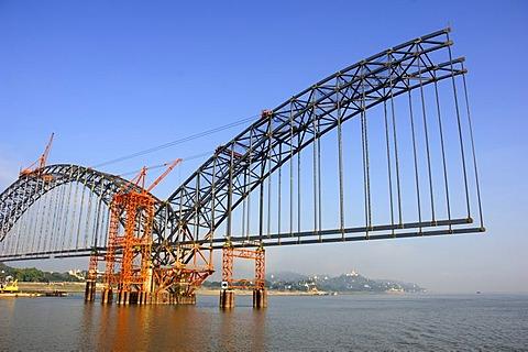 Construction of a new bridge crossing river Irawaddy in Myanmar near Ava, Burma