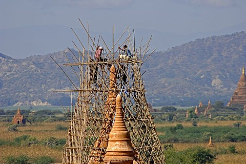 Working on a pagoda, Pagan, Bagan, Myanmar, Burma