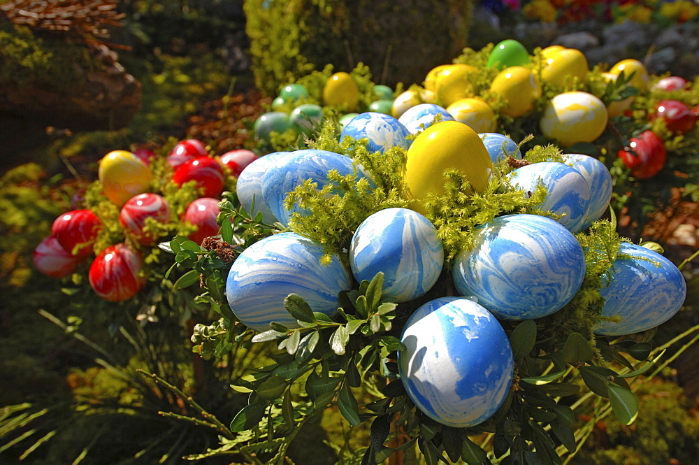 Easter decorations (easter eggs) on a fountain, Bieberach, Franconian Switzerland region, Bavaria, Germany, Europe