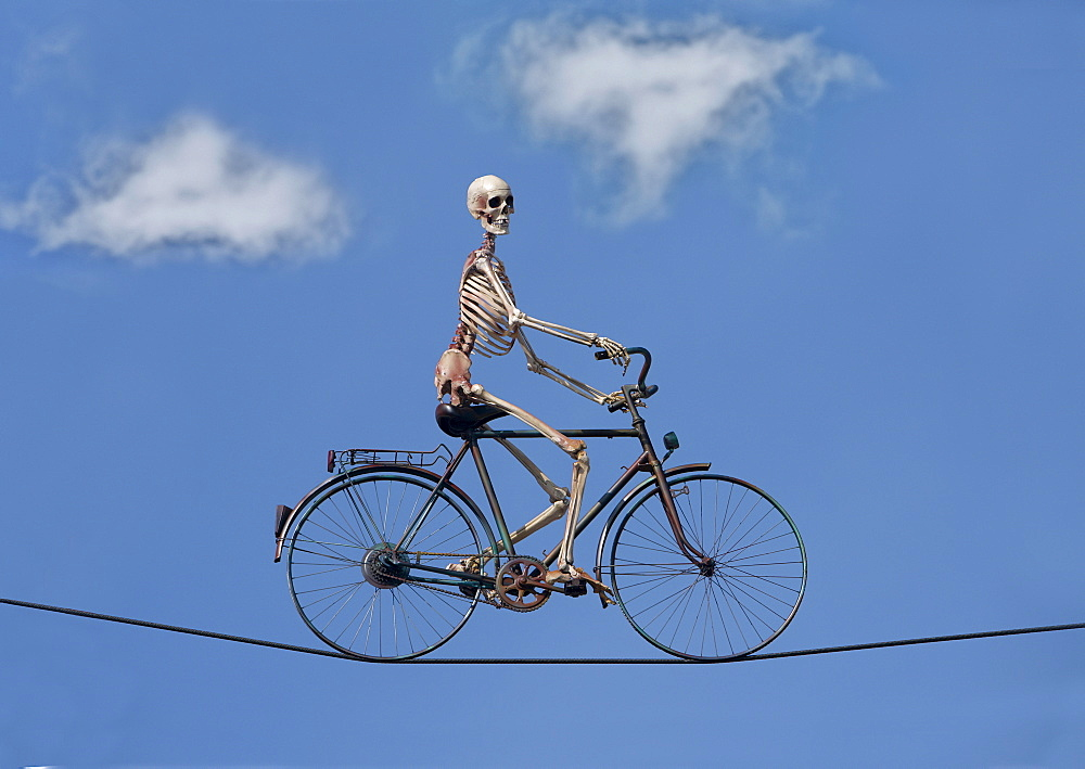 Sceleton rides bicycle on high-wire