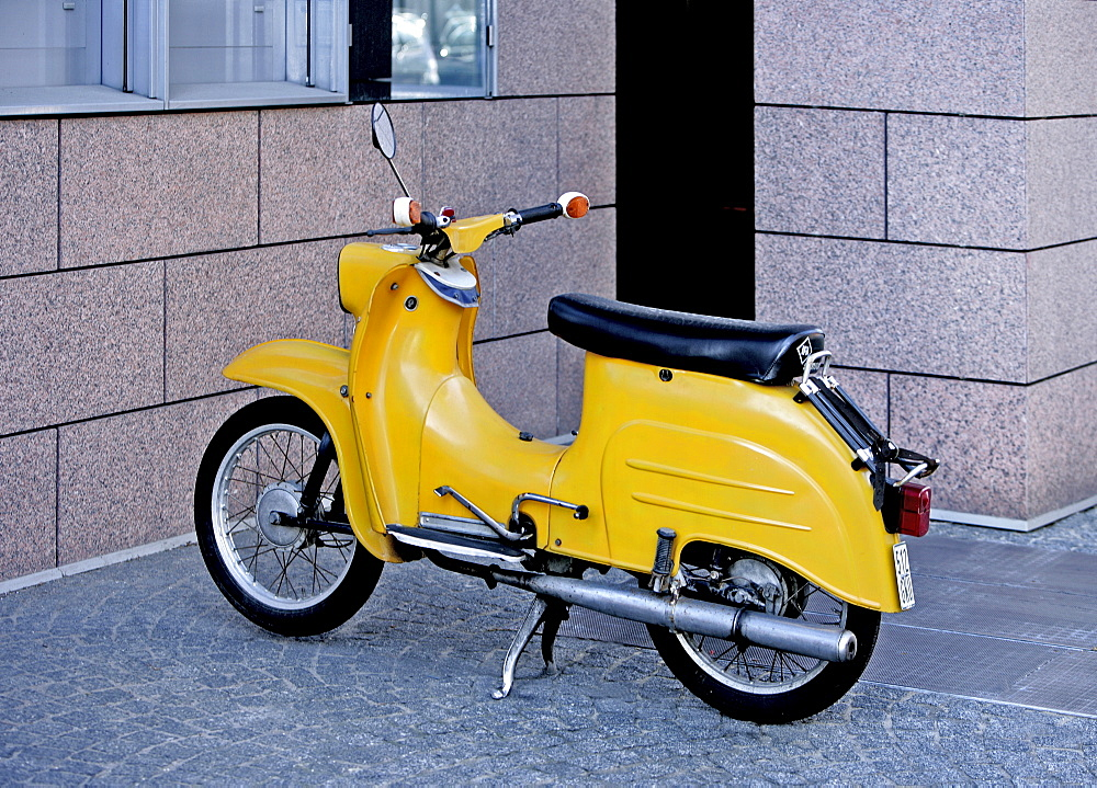 Yellow motor-scooter