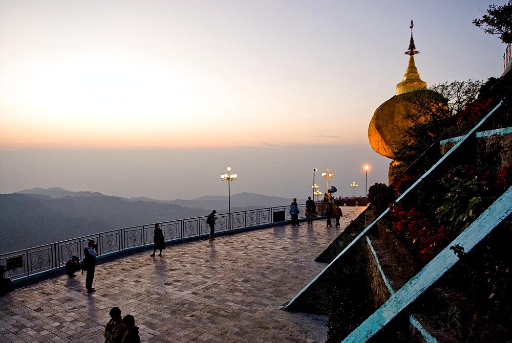 Golden rock and stupa at sunset, Kyaikhtiyo, Myanmar (Burma), Southeast Asia