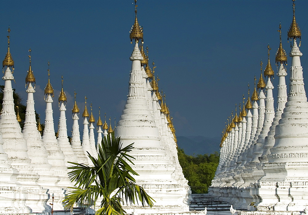 Lots of golden-tipped white stupas in three rows, Mandalay, Myanmar (Burma), Southeast Asia